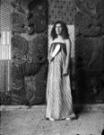 Full length portrait of guide Maggie Tawhai, weari...