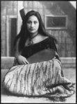 Martha Isabell Bevan, circa 1901. She wears a tiki...
