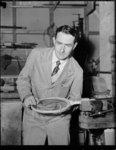 A man repairing a tennis racqet photographed 1951 ...