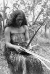 (Rakara?) Chadwick, weaving a rourou (flax food ba...